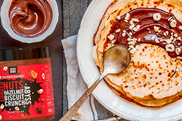 Protein Works spread on table with crepe