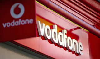 Vodafone signage seen outside a store in central London on September 4, 2013. US telecoms giant Verizon, and Vodafone announced Monday they had agreed the British company would sell out its 4