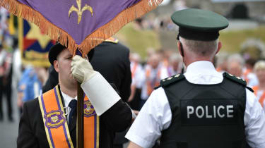 Orangemen are stopped by a PSNI officer during a parade in Portadown this week