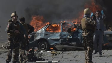 Afghan security forces personnel are seen at the site of a car bomb attack in Kabul on May 31, 2017.At least 40 people were killed or wounded on May 31 as a massive blast ripped through Kabul