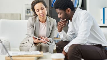 Man and woman consulting finances