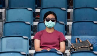 A spectator at the Australian Open, which has been affected by smoke from bushfires