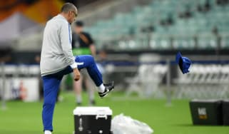 Chelsea boss Maurizio Sarri kicks his cap in frustration during the training session in Baku