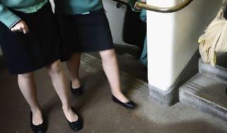 Two female pupils wearing school uniform