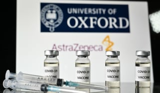 Vials of the Oxford Covid-19 vaccine in front of a sign for Oxford University