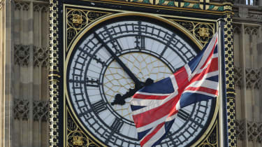 A Union Flag flies in front of the clockface of Elizabeth Tower