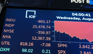 NEW YORK, NEW YORK - AUGUST 14: A board displays the closing numbers on the floor of the New York Stock Exchange (NYSE) on August 14, 2019 in New York City. Following news of an economic slow
