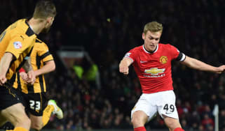 James Wilson of Manchester United in action during the march with Cambridge United