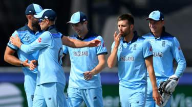 England bowler Mark Wood celebrates his run out of New Zealand's Kane Williamson