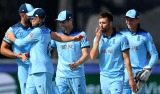 England bowler Mark Wood celebrates his run out of New Zealand's Kane Williamson