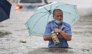 Man walks in flood