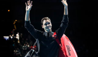 Roger Federer waves to the crowd after his victory against Novak Djokovic