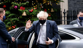 Boris Johnson gestures on his return to 10 Downing Street.