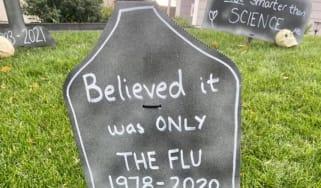 A headstone reading 'Believed it was on the Flu'