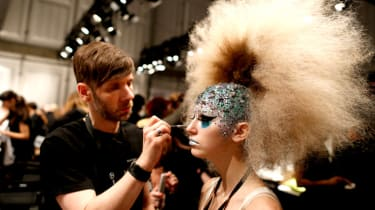 BERLIN, GERMANY - JANUARY 19:A model is seen backstage ahead of the It's Showtime - Maybelline New York 100th Anniversary show during the Mercedes-Benz Fashion Week Berlin Autumn/Winter 2015/