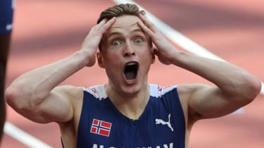 Karsten Warholm reacts after breaking the 400m hurdles world record