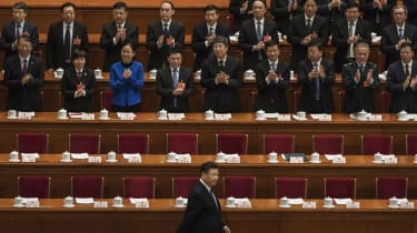 President Xi Jinping is applauded as he arrives at a session of the National People's Congress