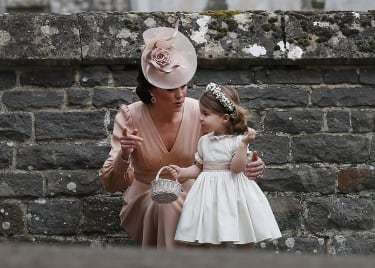 TOPSHOT - Britain's Catherine, Duchess of Cambridge (L) speaks to her daughter Britain's princess Charlotte, a bridesmaid, following the wedding of her sister Pippa Middleton to James Matthew