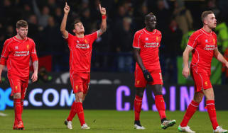 Philippe Coutinho of Liverpool celebrates scoring the second goal