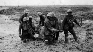 A stretcher-bearing party carrying a wounded soldier through the mud near Boesinghe during the battle of Passchendaele in Flanders. (Photo by John Warwick Brooke/Getty Images)