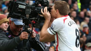 MANCHESTER, ENGLAND - MARCH 16:Steven Gerrard of Liverpool celebrates scoring the second goal by kissing the steadicam during the Barclays Premier League match between Manchester United and L