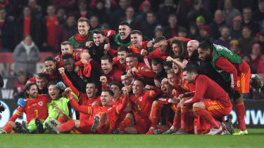 The Welsh squad celebrate their victory over Hungary at Cardiff City Stadium