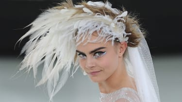 PARIS, FRANCE - JANUARY 21:Model Cara Delevingne walks the runway during the Chanel show as part of Paris Fashion Week Haute-Couture Spring/Summer 2014 on January 21, 2014 in Paris, France.(P