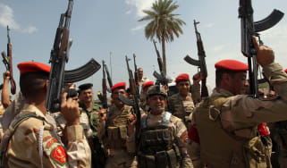 Iraqi army troops chant slogans against the Islamic State of Iraq and Syria (Isis)