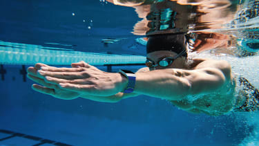 Lifestyle photo of Caucasian Male Swimming Outdoors with Ionic Cobalt/Lime Sport Band