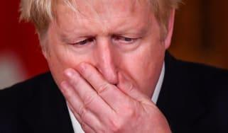 Boris Johnson addresses a press briefing on the new Covid-19 lockdown system