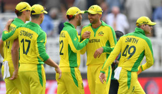Australia's Nathan Lyon (second right) celebrates a wicket against England on 25 June