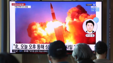 South Koreans watch the North Korean missile launch