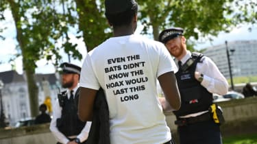 A man attends an anti-lockdown protest outside Westminster