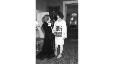 Prime Minister Margaret Thatcher greets fashion designer Katharine Hamnett, wearing a t-shirt with a nuclear missile protest message, at 10 Downing Street, where she hosted a reception for Br