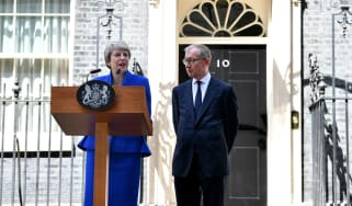 Outgoing prime minister Theresa May gives her final speech beside husband Philip May outside 10 Downing Street on 24 July