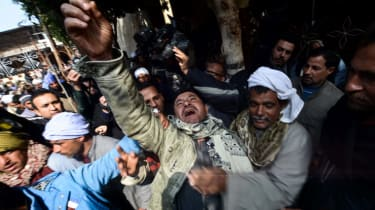 A relative of one of the Egyptian Coptic Christians purportedly murdered by Islamic State (IS) group militants in Libya reacts after hearing the news on February 16, 2015 in the village of Al