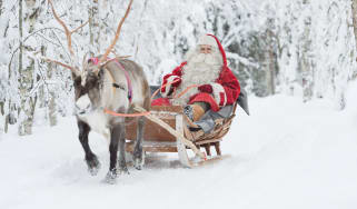 Santa riding in a sleigh in Finland