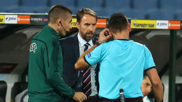 England boss Gareth Southgate speaks with the match officials during the 6-0 win against Bulgaria