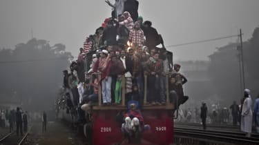 TONGI, BANGLADESH - JANUARY 18:Muslim devotees arrive to Tongi on the last day of the annual Bishwa Ijtema on January 18, 2015 in Tongi, Bangladesh. The Bishwa Ijtema is the second largest ga