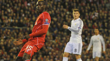 Mario Balotelli watches his shot go wide of the goal during match between Liverpool and Real Madrid at Anfield in Liverpool