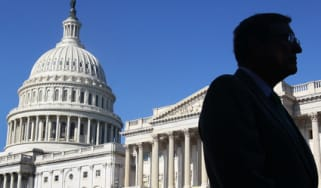 A man walks past the US Senate on Capitol Hill, Washington