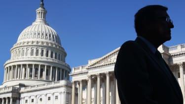 A man walks past the US Senate on Capitol Hill, Washington