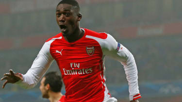 Yaya Sanogo of Arsenal celebrates after scoring the opening goal during the match between Arsenal and Borussia Dortmund