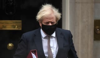 Boris Johnson leaves number 10 Downing Street for PMQs.