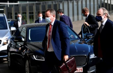 Britain's chief Brexit negotiator David Frost (C) arrives to meet his EU counterpart for Brexit negotiations at the EU headquarters in Brussels on September 17, 2020. - The chief negotiators
