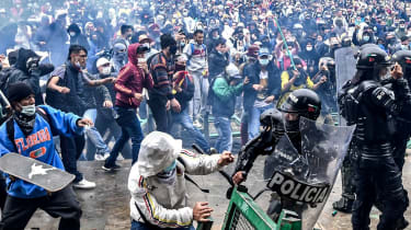 Protesters clash with riot police in Bogota