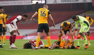 Arsenal's David Luiz and Wolves's Raul Jimenez lie injured after their clash of heads