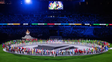 The flag bearers at the closing ceremony of the Tokyo 2020 Olympic Games