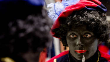 Woman has her face painted to become Zwarte Piet (Black Pete)