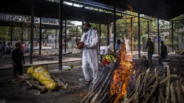 Funeral pyres burning in New Delhi, India